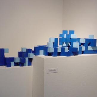 modular four-cube elements combined in a unique arrangement