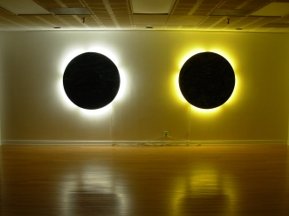 interactive installation in which visitors were encouraged to write a secret on the round panels, which represented the moon and the sun in eclipse