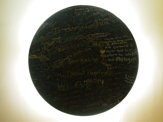 "hardboard, fluorescent lights, chalkboard paint, chalk, 48"" diameter"