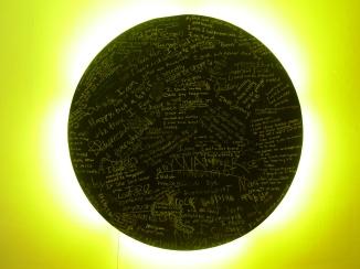 "hardboard, fluorescent lights, chalkboard paint, chalk, 48"" diameter"